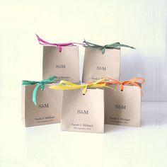 Cute different Kraft favour bags with a pretty colour accent