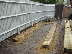 The old fence was cleaned with Owatrol Net-trol and painted with Owatrol Solid Colour Stain. Sleepers In Garden, Railway Sleepers, Old Fences, Raised Beds, Outdoor Rooms, Old Things, Urban, Colour, Wood