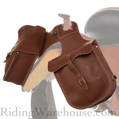 Designed to carry the necessities for a day's ride, the Weaver Chap Leather Horn Front Pommel Saddlebag offers functionality and traditional style for the modern trail rider.