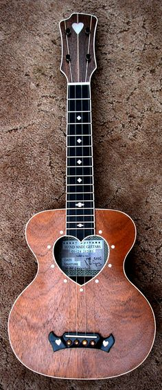 I love the heart in the middle of this. The whole design is just awesome!! A Degay Guitars ukulele.