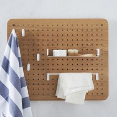 The Universal Expert Peg Board Organizer is a smart take on the classic hole-board design with its range of powder-coated steel accessories. Mount it on the wall in a pantry or laundry room and store small tools and cleaning supplies.