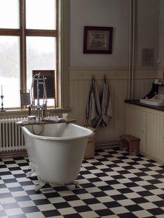 Bathroom Interior At North Peace-Norrfrid Yellow Bathroom Accessories, Interior Styling, Interior Decorating, Yellow Bathrooms, Wood Look Tile, Bathroom Floor Tiles, Bathroom Rugs, Beautiful Bathrooms, House Rooms