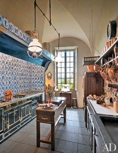 Architectural Digest - Updated kitchen features a La Cornue range, copper cookware decor and antique lantern pendants, in central France. French Kitchen, Beautiful Kitchens, Rustic Kitchen Design, Kitchen Remodel, Kitchen Dining, Kitchen Styling, Rustic Kitchen, Architectural Digest, Kitchen Design
