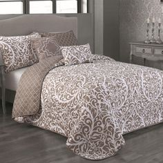 Dreams do come true with the chic and cozy comfort of our stylish damask bedding. This reversible quilt and matching shams plus decorative pillows welcome you home with its inviting design.