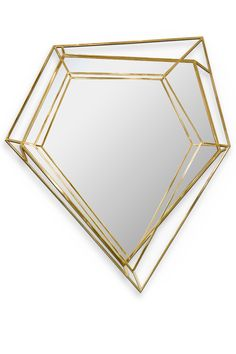 Inspired by the asymmetrical and dazzling shapes of a Diamond rock, this five-sided polygon mirror is the ultimate combination of geometry and design. The use of a polished brass structure enhances the luxurious element within this object resulting in a sophisticated dynamic piece that stands out in any ambience.