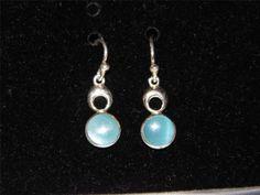 Very Cute Sterling Silver round light blue dangle earrings.   $0.01 s/b.