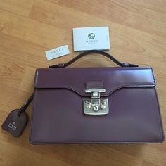 New Gucci maroon purple hand bag with Padlock A structured leather bag with key lock closure.  It's a top handle bag. Made in fine grain leather, noted for its shine and softness. This is brand new! Never worn or used! It comes with authenticity cards and wipe cloth for the bag. It's medium size 12inch height x 7.5inch width x 4inch depth. There is 2 pockets inside one zip one divider. Inside Camel alcantara fabric lining with a suede-like finish made in Italy Gucci Bags Totes