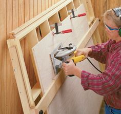 It's easy to cut sheet goods down to size with this tilt-out panel cutting guide. Woodworking Projects That Sell, Woodworking Patterns, Woodworking Workbench, Woodworking Workshop, Woodworking Supplies, Woodworking Tools, Palette Projects, Diy Projects, Woodsmith Plans