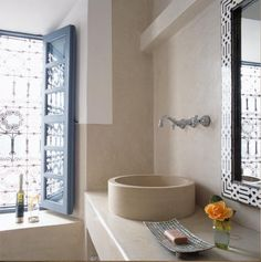 Love this, so clean so beige so lovely. Moroccan bathroom