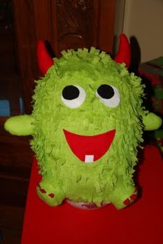 A cute little monster pinata I made for a friend's son's 1st Birthday