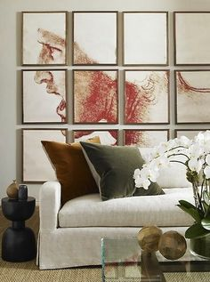 Havens South Designs loves this living room by Jon Call for his mail client. Sofa from Restoration Hardware, Art done by designer on his own office copier.