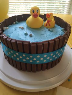 "Rubber duck kit kat cake. Two-layer yellow cake inside. Homemade buttercream icing. Full-sized Kit Kat cut to size and covered with ribbon. Sixlets candies for ""bubbles""."