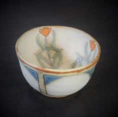 A personal favorite from my Etsy shop https://www.etsy.com/listing/228861675/tulip-craftsman-art-pottery-bowl-by
