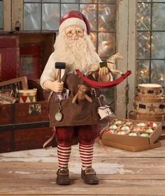 Get a glimpse of the toys and gifts Santa creates at his workshop. Old Fashioned Workshop Santa holds a toy rocking horse and mallet. A pocket watch and some of