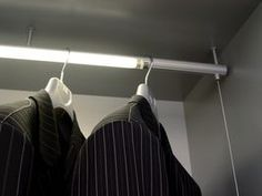 Hide your valuables behind the end of a closet clothes pole.