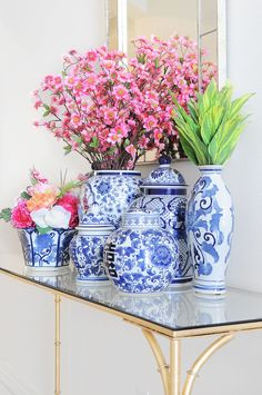 Floral & Colorful Eclectic Spring Home Tour - Monica Wants It - A chinoiserie collection of ginger jars and florals look chic styled on a console table in a foyer. Chinoiserie Chic, Blue And White China, Asian Decor, Ginger Jars, Spring Home, Elegant Homes, White Decor, Look Chic, Vintage Home Decor