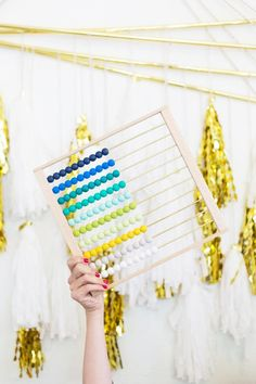 Make counting colorful with this ombré abacus DIY.