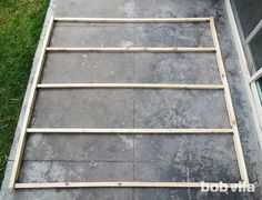 A neighbor lays a wood frame on his walkway. His privacy idea? Get ready to gasp!