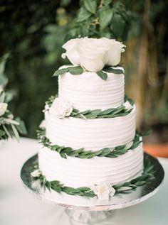 white wedding cake, white roses on wedding cake