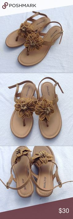 Tan Flowered Sandals Super cute sandals that go with just about everything. Never worn but no tags. Size 6.5M. Rialto Shoes Sandals