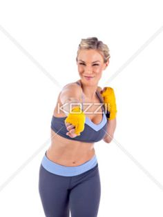 young woman punching over white background - Portrait of young woman in fighting stance isolated over white background