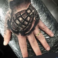 Black and Grey Hand Tattoo by Dylan Weber Cool Forearm Tattoos, Dope Tattoos, Head Tattoos, Cover Up Tattoos, Skull Sleeve Tattoos, Best Sleeve Tattoos, Hand Tats, Hand Tattoos For Guys, Grenade Tattoo