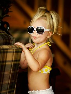Yellow polka-dot bikini. Oversized shades. Pebbles style ponytail. Kissy fish lips. Set, Can I take her home?!