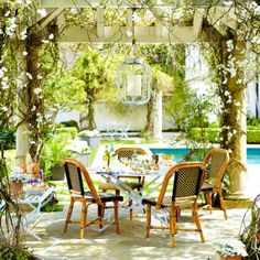 Bring the indoors outdoors with these design ideas for summer. Image via Domino Magazine.