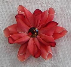 Thank you for stopping by my store today.  You will receive one 2 pc set of Coral wired ombre ribbon flowers. Each flower tip is shaded. The ribbons are folded and hand stitched to create these beautiful flowers. The centers are also embellished with a hand stitched acrylic faceted stone. So pretty and would be great to use for shoe clips, clothing, jewelry or hair accessories. I have many colors available as shown in the last photo. Please contact me if you would like another color if not…