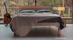Tibet maple wooden bed is shown here with our Ethiopia Grey duvet cover and a loose-knit Linum throw in ivory.   Feel free to pin!