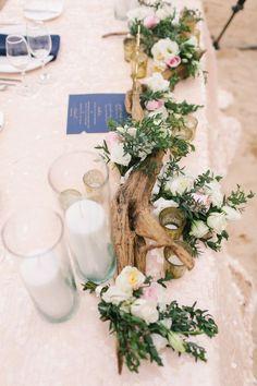 rustic driftwood wedding centerpiece / http://www.deerpearlflowers.com/driftwood-wedding-decor-ideas/