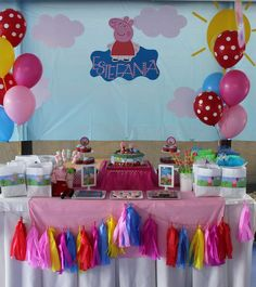 Colorful dessert table at a Peppa Pig birthday party! See more party ideas at CatchMyParty.com!