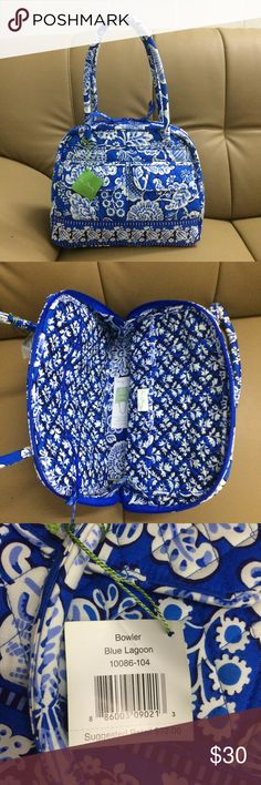 "Vera Bradley Bowler Satchel Bag Blue Lagoon My price is final price, please don't make offer new with tag, from a smoke free home. Inside, one zip and six slip pockets Front and back pockets Rolled handles Care Tips: Spot clean with a damp cloth Measures: 14 1/2"" x 10 1/4"" x 5"" with 9 1/2"" strap drop Vera Bradley Bags Satchels"
