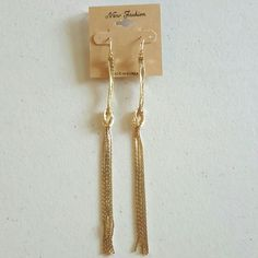 Long Gold Color Drop and Dangle Earrings Metal color is gold and are 5 and  1/2 inches long. Jewelry Earrings