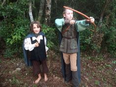 Our DIY lord of the rings costumes. Legolas and Frodo. Mostly secondhand clothes from a thrift store. Made the pins with clay. The embroidered tunic was a woman's blazer, we used the sleeves for his boots and cinched it in the back.