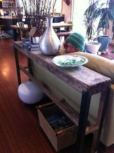 Decorated Long Sofa Table - http://www.interior-design-mag.com/home-design-ideas/decorated-long-sofa-table.html