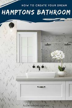 hamptons style bathroom with marble herringbone tiles and floating vanity and black tapware