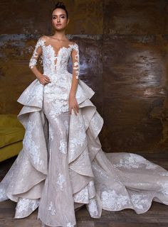 Crystal Design: NIKA An incredible wedding gown. Stunning column dress has long sleeves. The removable overskirt has sparkle throughout.