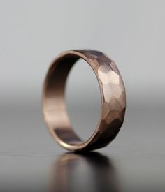 This stunning pressed rose gold wedding band by lolide via etsy is perfect for the rugged groom. #groomweddingband #rosegold #groom