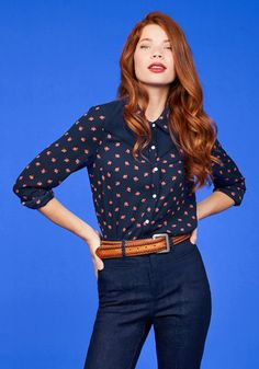 Even though pieces like this navy blue blouse have been around since the '70s, you still can't get enough! Fastened with snaps, patterned with deep pink roses, and filled with western flair, this ModCloth namesake label top satisfies your taste for indie style.