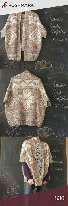 American Eagle Outfitters Wool Blend Sweater Sz S American Eagle Outfitters FairIsle Style Sweater Cardigan Poncho Shrug Oversized.  69% Acrylic, 25% Wool, 2% Alpaca, 4% other fiber  Chunky knit, open cardigan, short sleeve loose fit.  Size says small but it is oversized and would easily fit Medium.  Excellent, like new condition.  Looks fantastic. No wash wear. Colors are great. Smoke and Pet free environment.  No Trades American Eagle Outfitters Sweaters