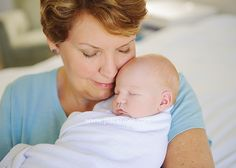grandma and newborn baby have a quiet snuggle moment together