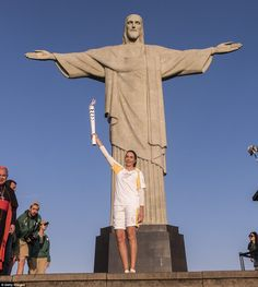Brazil's former volleyball player Isabel Barroso Salgado carried the Olympic torch in fron...