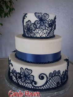 3 Tier Wedding Cake with Navy Blue Midnight blue line work flowers and ribbon accent from Candy Haven, in Denton, TX