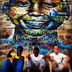 Kibera Walls for Peace youth arts project; Nairobi, Kenya. With my friends Ngesh and Mathew