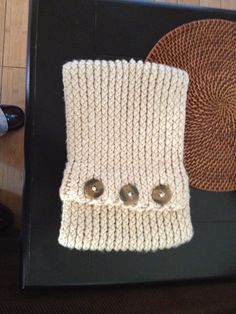 Knifty Knitter neck roll.
