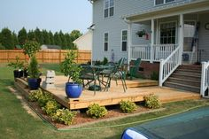 In case we ever moved into a plan box house, I would add this porch & a huge deck off the back similar to this.
