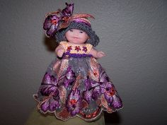 # 754 Purple/orange/peach and grey lace dress with matching hat.