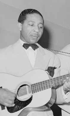 1990 ♦ Lonnie Johnson (1899 - 1970) - American blues and jazz singer/guitarist, violinist and songwriter who pioneered the role of jazz guitar and jazz violin, and is recognized as the first to play an electrically-amplified violin.