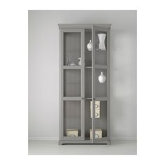 LIATORP Glass-door cabinet IKEA 3 adjustable glass shelves.  Adjust spacing according to your storage needs.